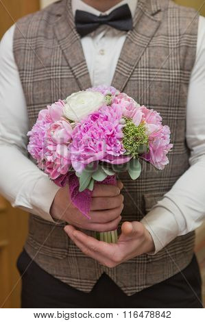 Wedding Bouquet In Groom Hand