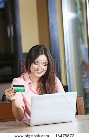 Young woman working with laptop in the office