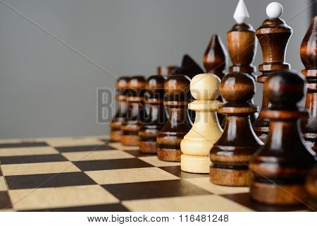 The White Pawn Among Black Pieces