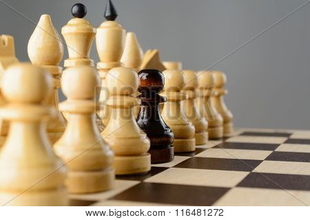 Black Pawn Among White Pieces