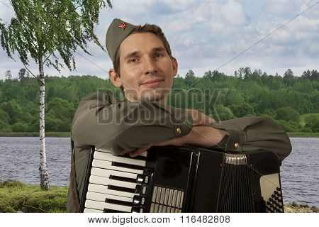 Portrait Of Soviet Soldier With Accordion Outdoors