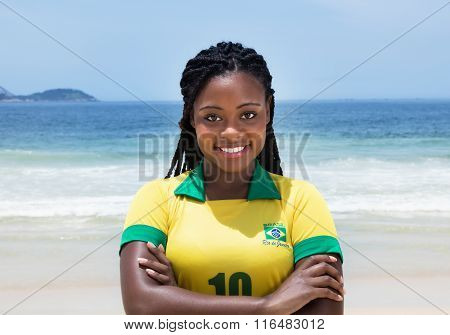 Happy Brazilian Woman In A Soccer Jersey At Beach