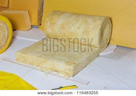 Thermal Insulation Role In Yellow Package At Attic Background
