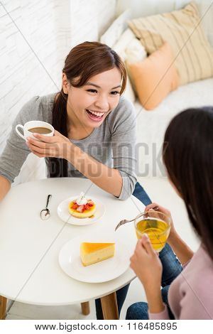 Two young girls enjoy their tea time