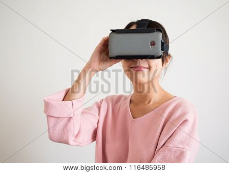 Woman look via virtual reality glasses