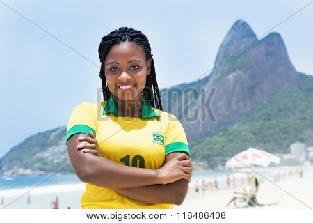Laughing Brazilian Woman In A Soccer Jersey At Beach
