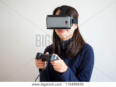 Woman play video game with joystick