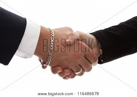 Two Persons Shaking Hands In Closeup