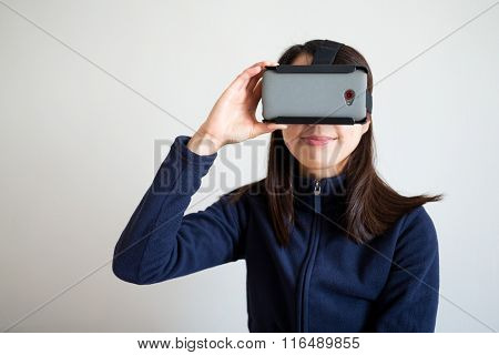 Woman watch via virtual reality glasses