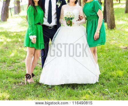 bride and her bridesmaids wearing light green bridesmaid dresses