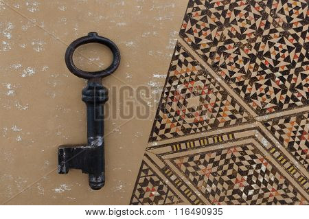 Old Key And Arrow On Golden Ancient Background