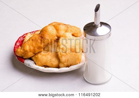 Bulgarian breakfast, fried dough with sugar - Mekitsi