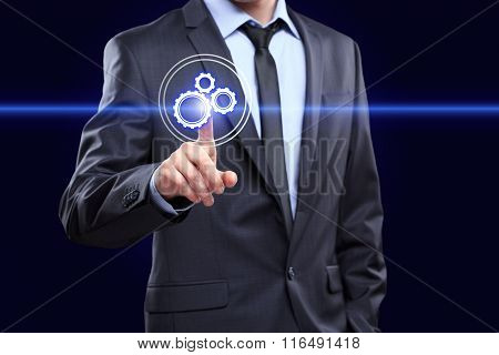 business, technology and internet concept - businessman pressing button with mechanism icon on virtu