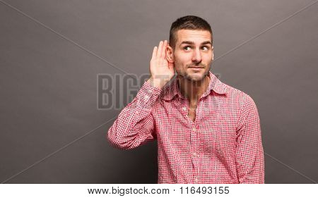 Man with his hand to ear