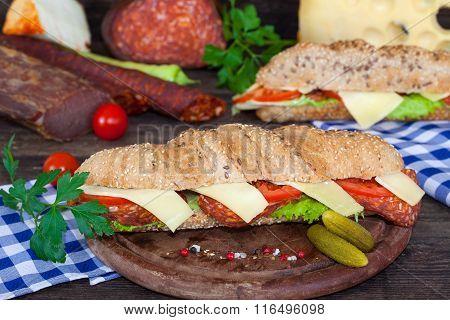 Ham and cheese submarine sandwiches