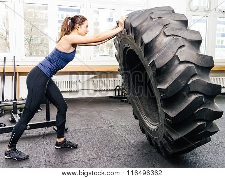Exercising With Tire At Gym