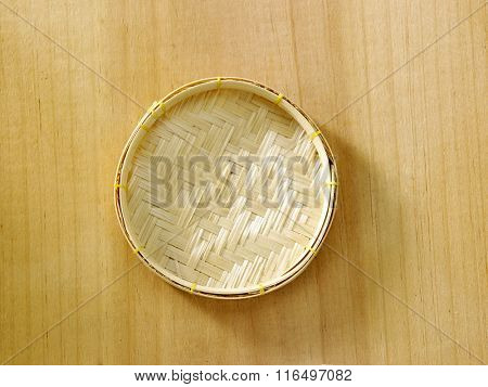 mini bamboo tray on the wooden background