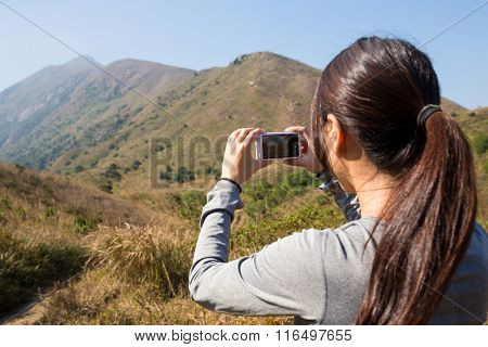 Woman take photo by digital camera