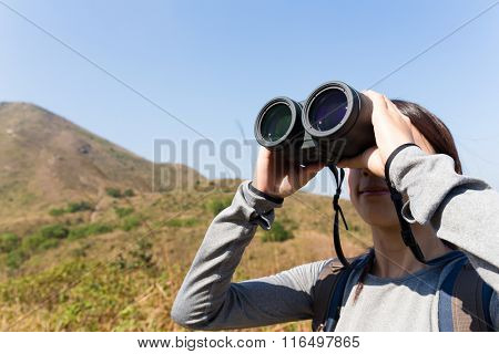 Tourist looking through binoculars