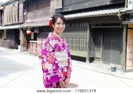 Woman with japanese kimono dressing
