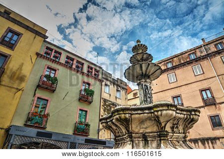 Fountain And Buildings In Bosa