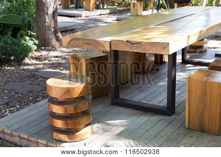 Wooden Table And Stool In The Garden