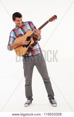 Joyful guy playing guitar.