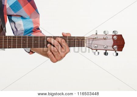 Fingerboard of guitar and hand playing guitar.