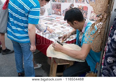Artist Making Thailand Traditional Shadow Puppet