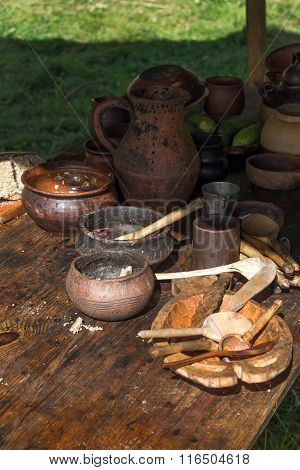 Ancient Wooden And Clay Dishes Left On Table After Dinner