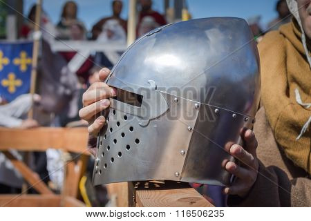 The Man On The Knight Tournament Holdind A Knights Helmet