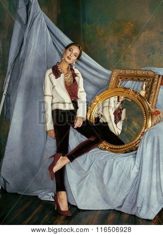 beauty rich brunette woman in luxury interior near empty frames, vintage elegance hispanic, home alo