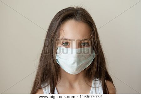 Girl in a medical mask and a vest