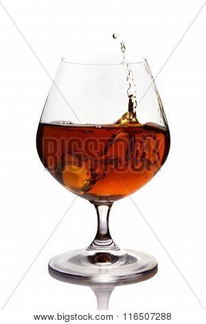 Splash of cognac in glass