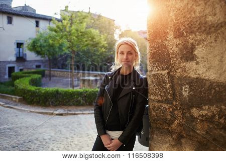 Young beautiful woman with cool style looking at camera while standing on the street