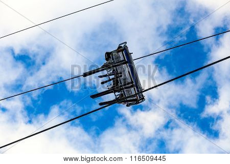 Bottom view of pair skiers on chair lift