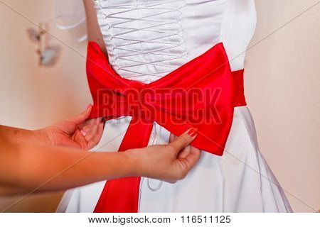 Red Bow Tie On The Bride's Dress
