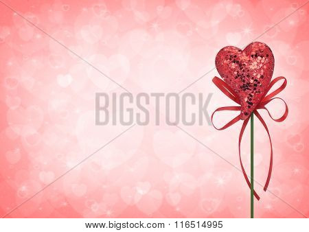Red Love Heart Toy With Bow On Light Red Heart Blur Background