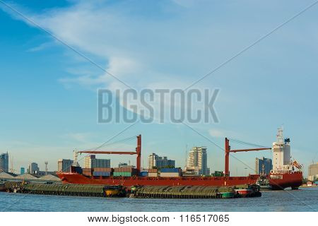 Cargo Ship On Blue Skies Background.
