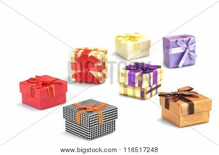 Many Colorful Gift Boxes Scattered On White Isolated Background