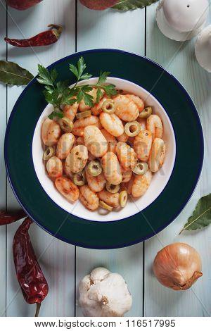 Gnocchi di patata, italian potato noodle with olives and tomato sauce