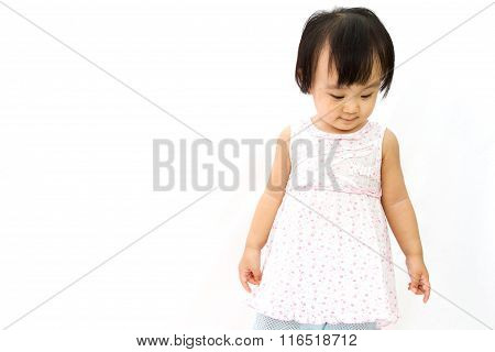 Chinese Little Girl Looks Down For A Portrait In Studio