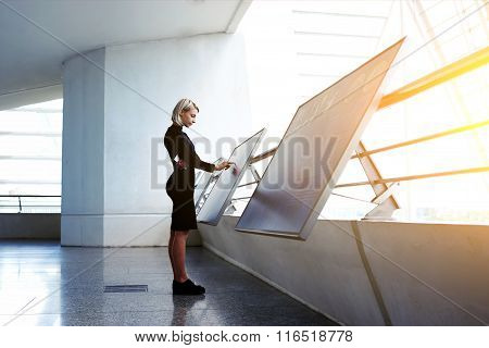 Businesswoman searching information on high tech modern device