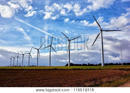 Electric generators in countryside windmills in work outside the city
