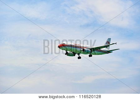 HONG KONG - JUNE 04, 2015: China Eastern Airlines aircraft landingt. China Eastern Airlines Corporation Limited is a major Chinese airline operating international, domestic and regional routes