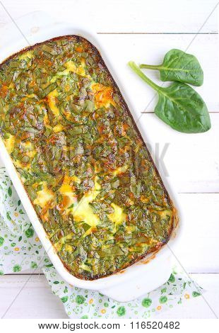 Baked Omelette With Spinach In A White Rectangular Shape
