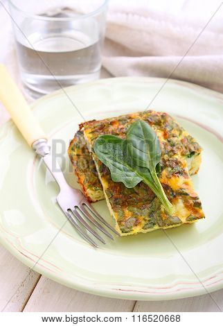 Baked Omelette With Spinach  White Plate On A White Background
