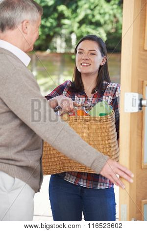 Teenage Girl Doing Shopping For Elderly Neighbour