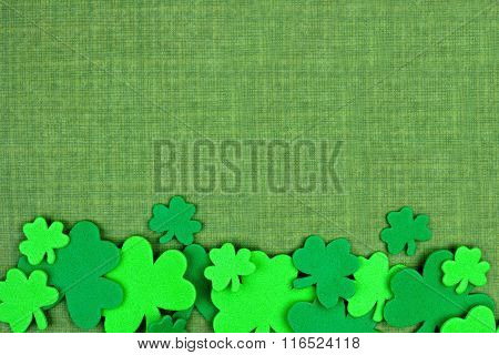 St Patricks Day bottom border of shamrocks over green linen