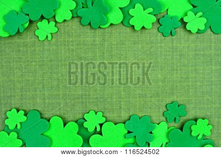 St Patricks Day double border of shamrocks over green linen